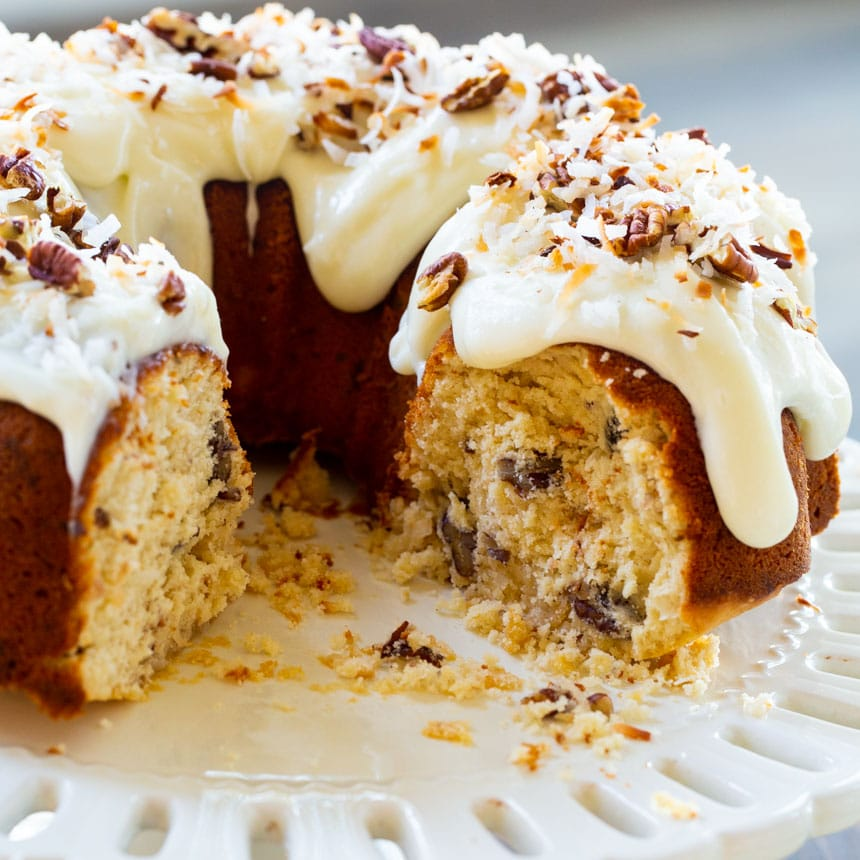 Bundt Cake with cream cheese glaze on cake stand.