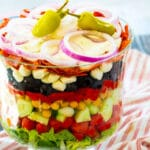Italian Layered Salad in a trifle bowl.
