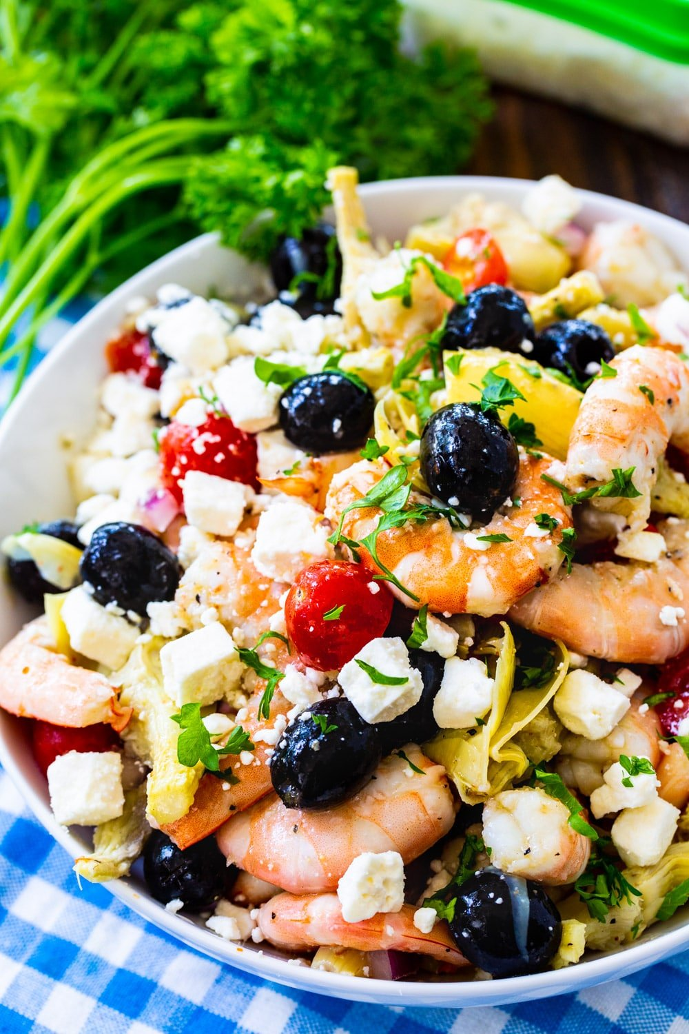 Italian Marinated Shrimp in a large bowl with fresh parlsey.
