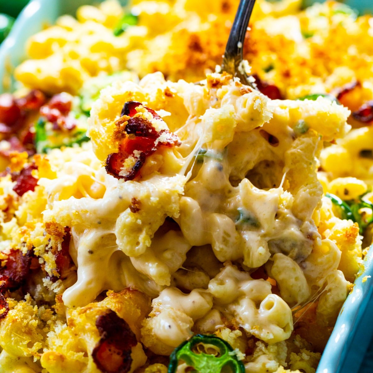 Serving spoon scooping Jalapeno Popper Mac and Cheese