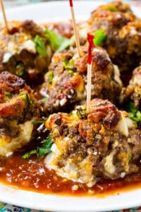 Jalapeno Popper Meatballs on a plate with toothpicks stuck in them.