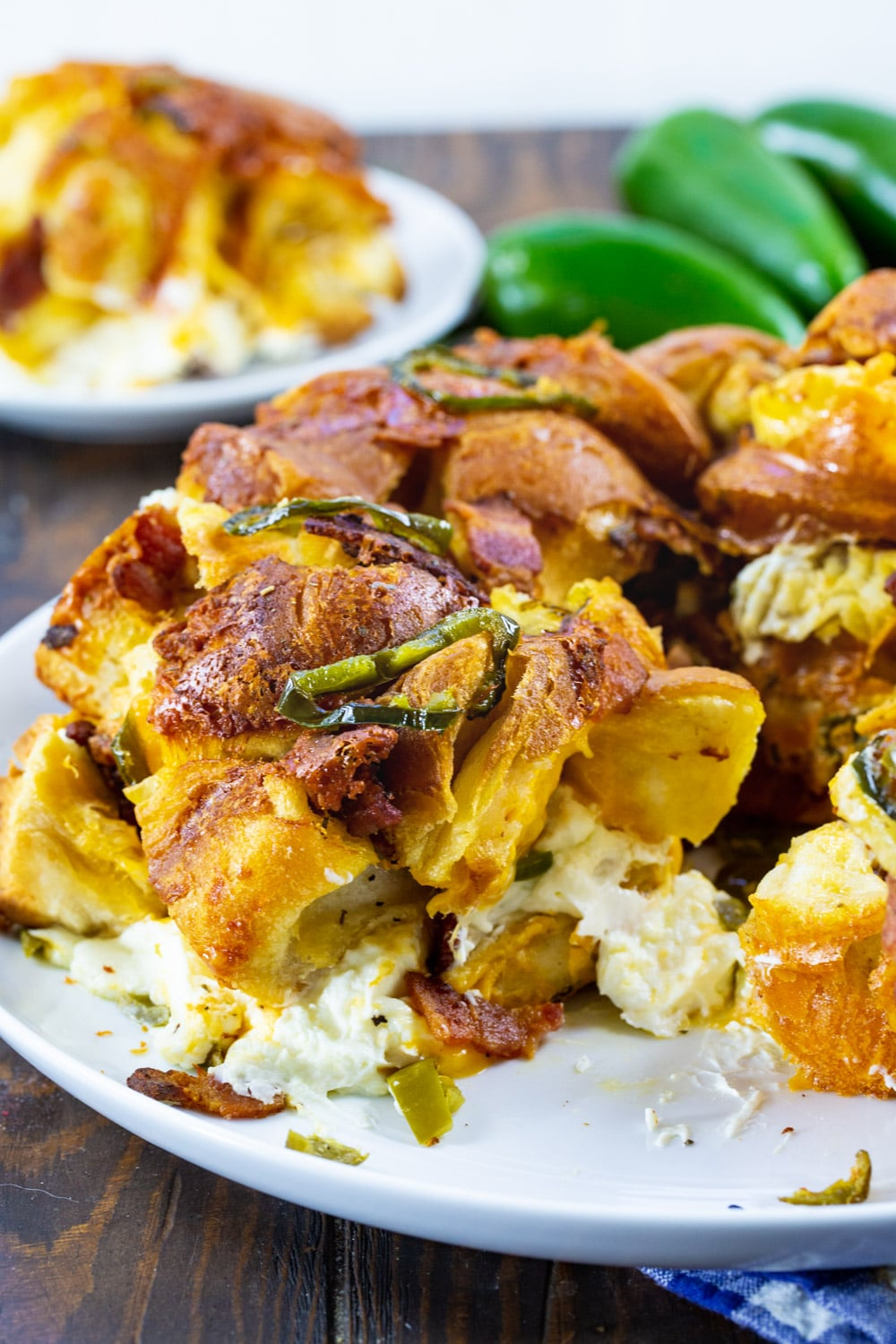 Jalapeno Popper Monkey Bread with piece removed to show the cream cheese in the middle.