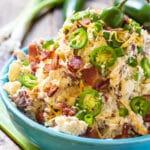 Jalapeno Popper Potato Salad in a blue serving bowl.