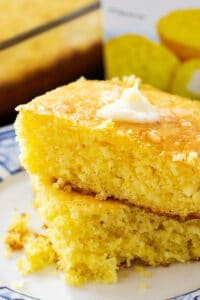 Two pieces of Jiffy Cornbread on a plate.