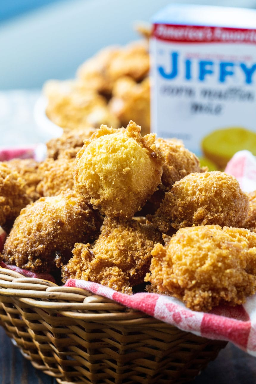 Hush Puppies in a basket with a box of Jiffy cornbread mix