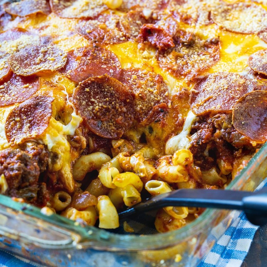 Casserole in baking dish with a spoon scooping a serving.
