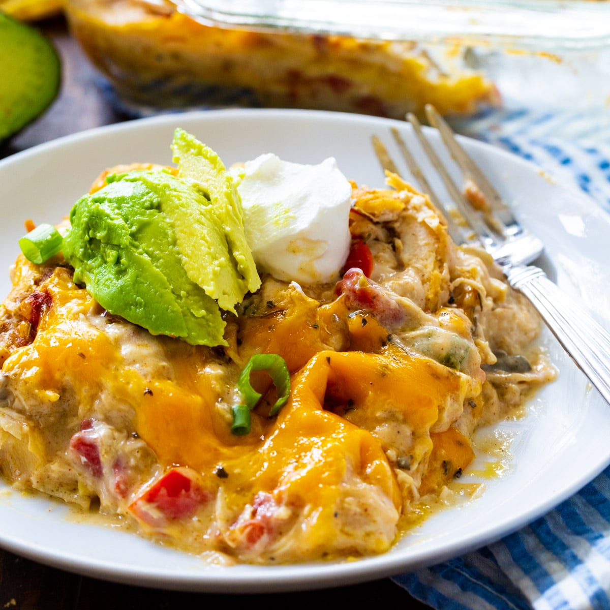 King Ranch Chicken Casserole topped with avocado on a plate.