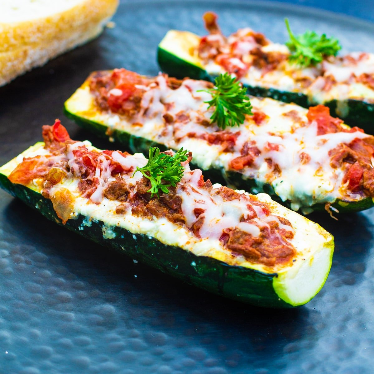 Three Zucchini Boats on a serving platter.