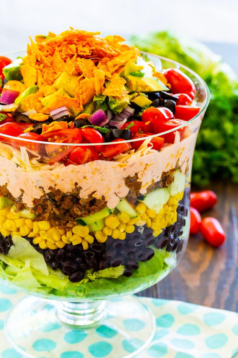 Layered Taco Salad in a trifle bowl.