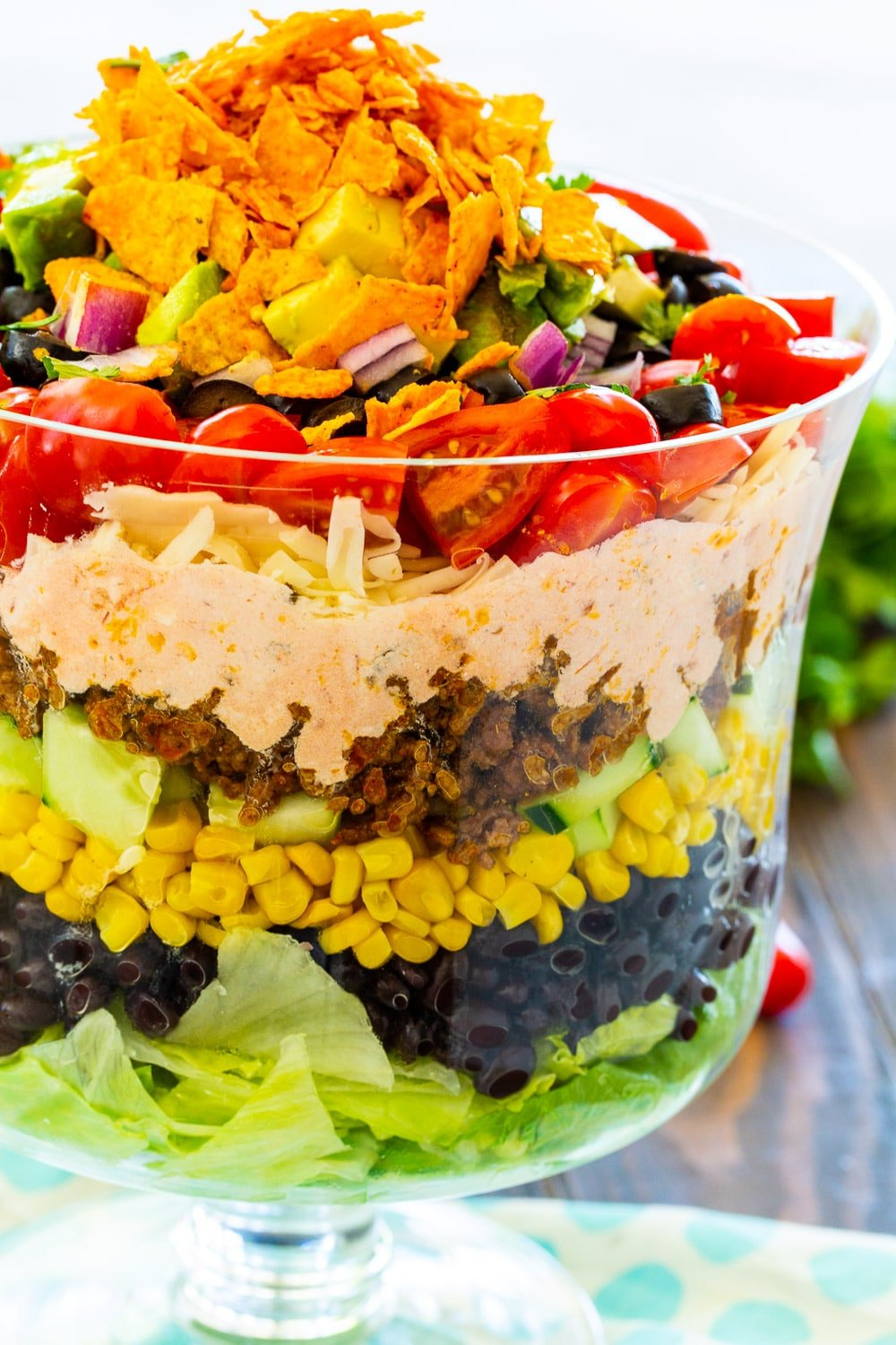Close-up of Layered Taco Salad showing the layers.