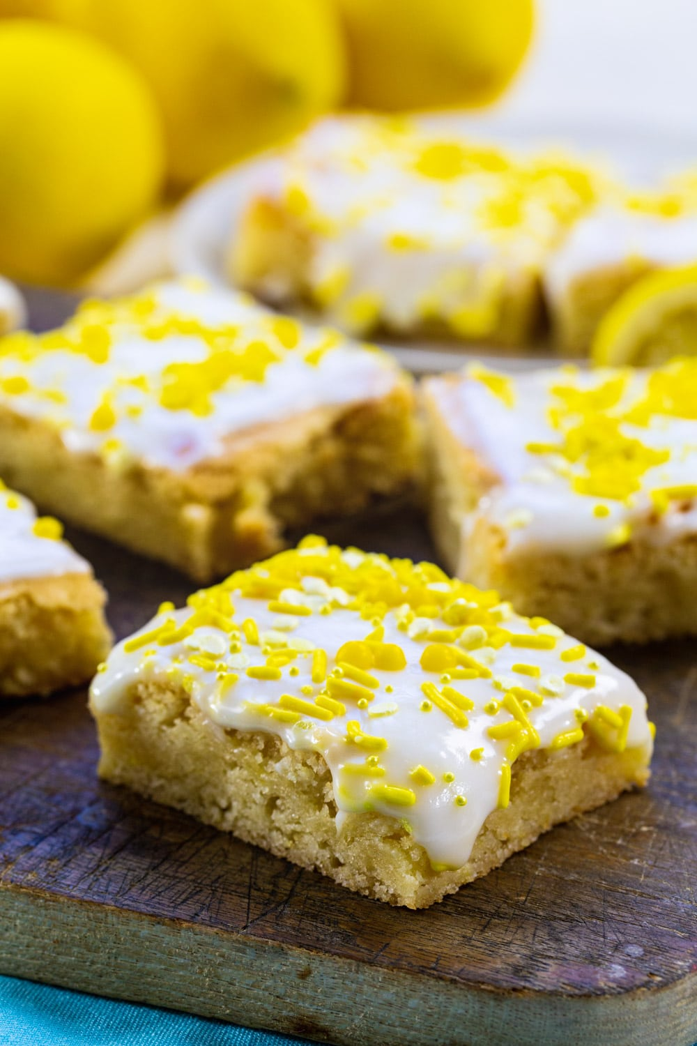 Lemon Cookie Bars topped with glaze and sprinkles.