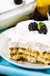 Slice of Lemon Icebox Cake topped with blackberries.