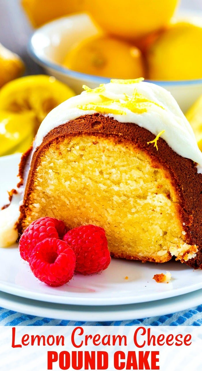 Close-up of slice of pound cake with 3 raspberries on plate.