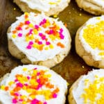 Lofthouse-Style Cookies covered in sprinkles on a baking sheet.