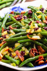 Maple-Glazed green beans with bacon, onions, and cranberries