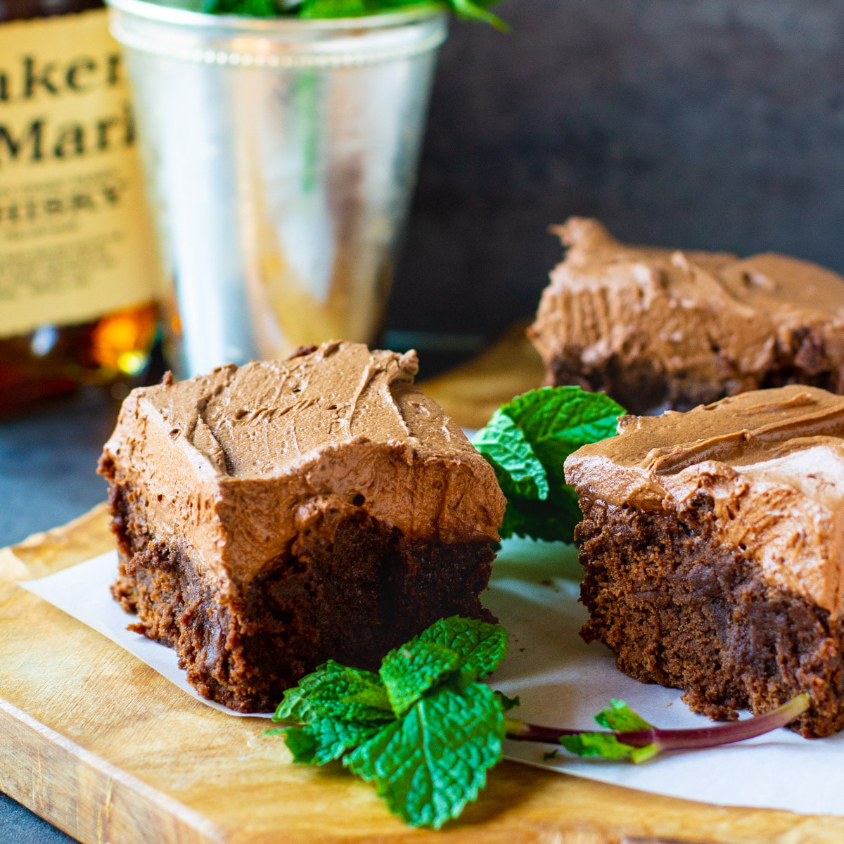 Mint Julep Brownies on a cutting board with fresh mint.