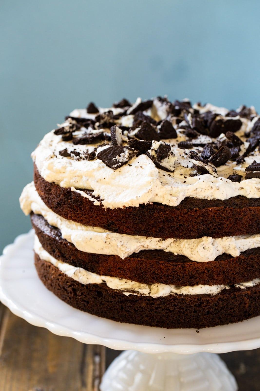 Three layer cake on cake stand.