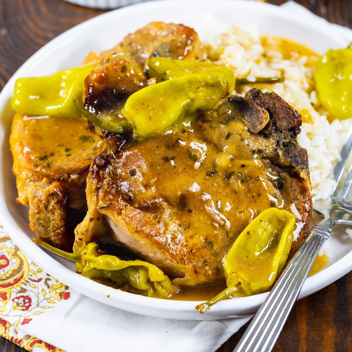 Two Slow Cooker Mississippi Pork Chops on a plate.
