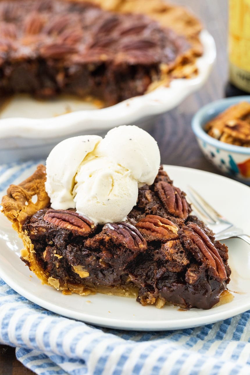Slice of Mocha Pecan Pie topped with ice cream.