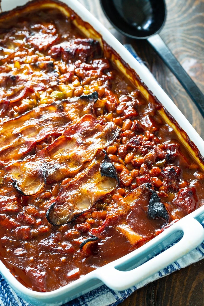 Molasses Baked Beans with Strips of bacon in a baking dish