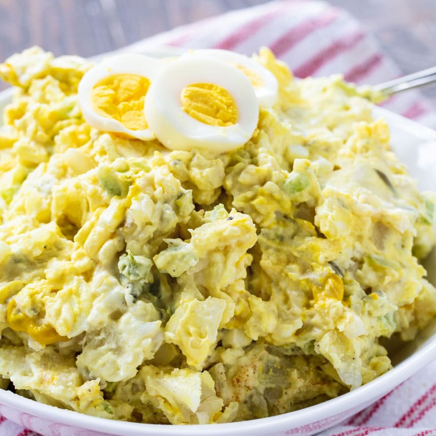 Mustard-Style Potato Salad in a white bowl.