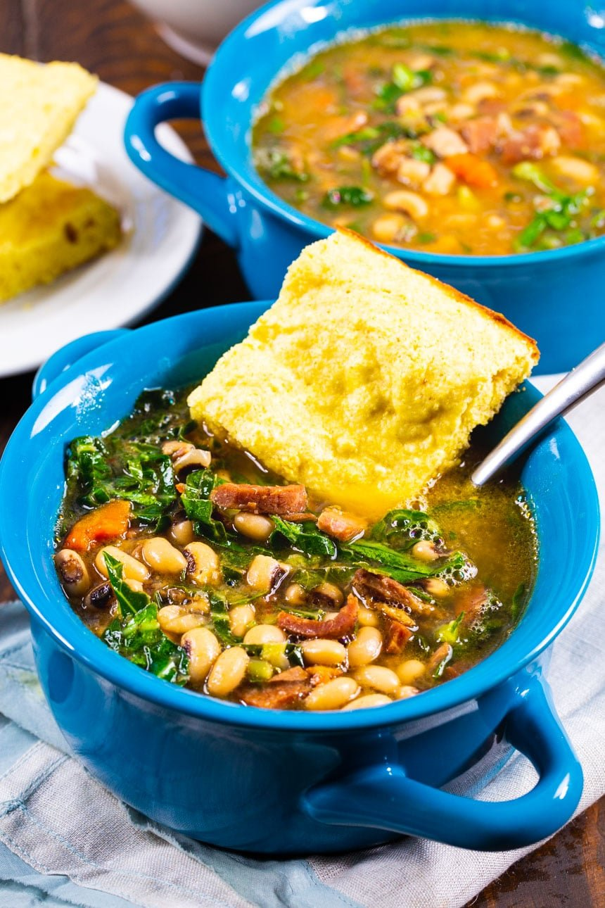 Black-Eyed Pea Soup with Collard Greens in soup bowls.