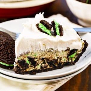 Slice of No-Bake Mint Oreo Pie on a plate.
