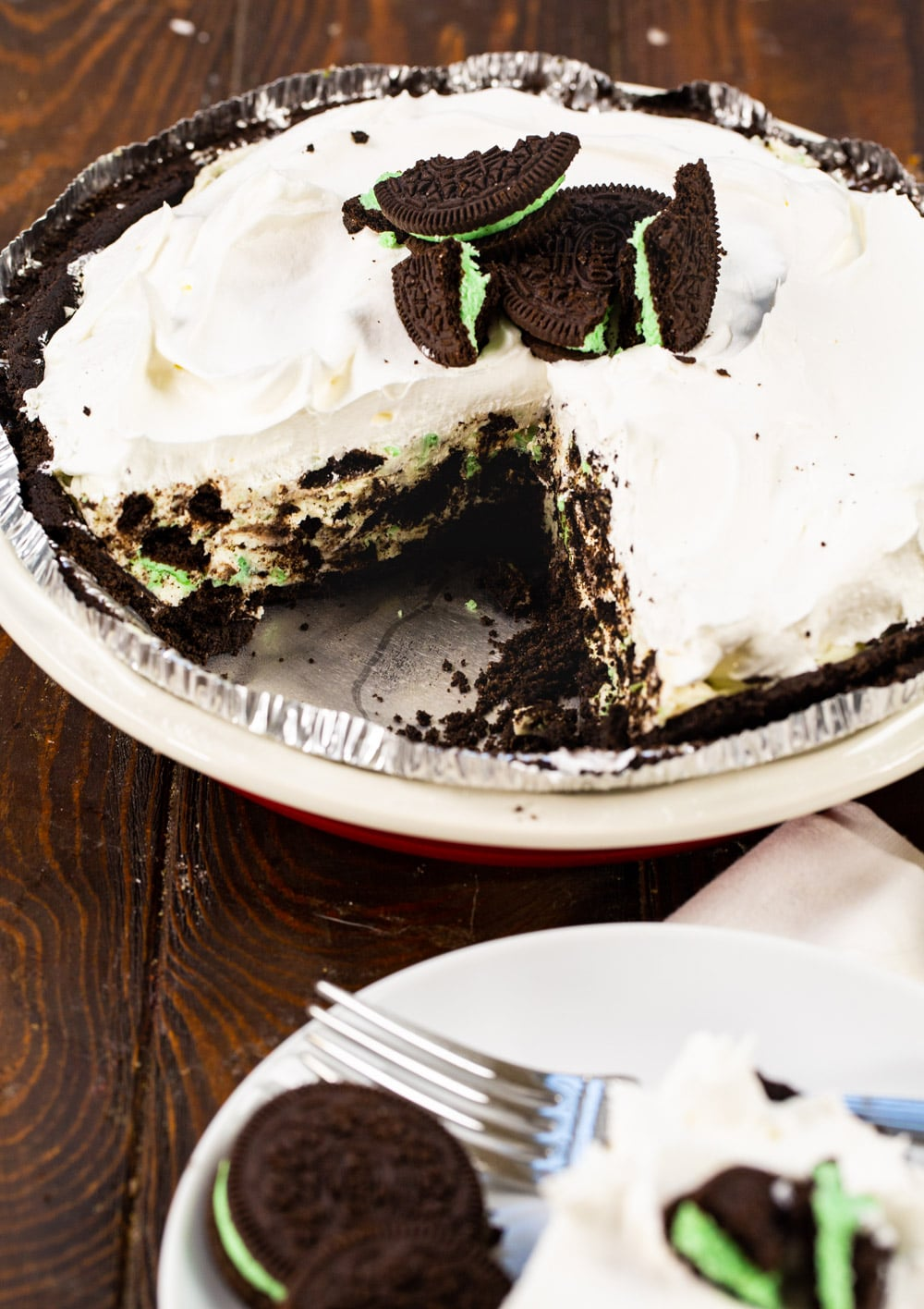 Mint Oreo Pie with a slice cut out.