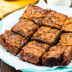 Nutella Brownies cut into squares on a plate.