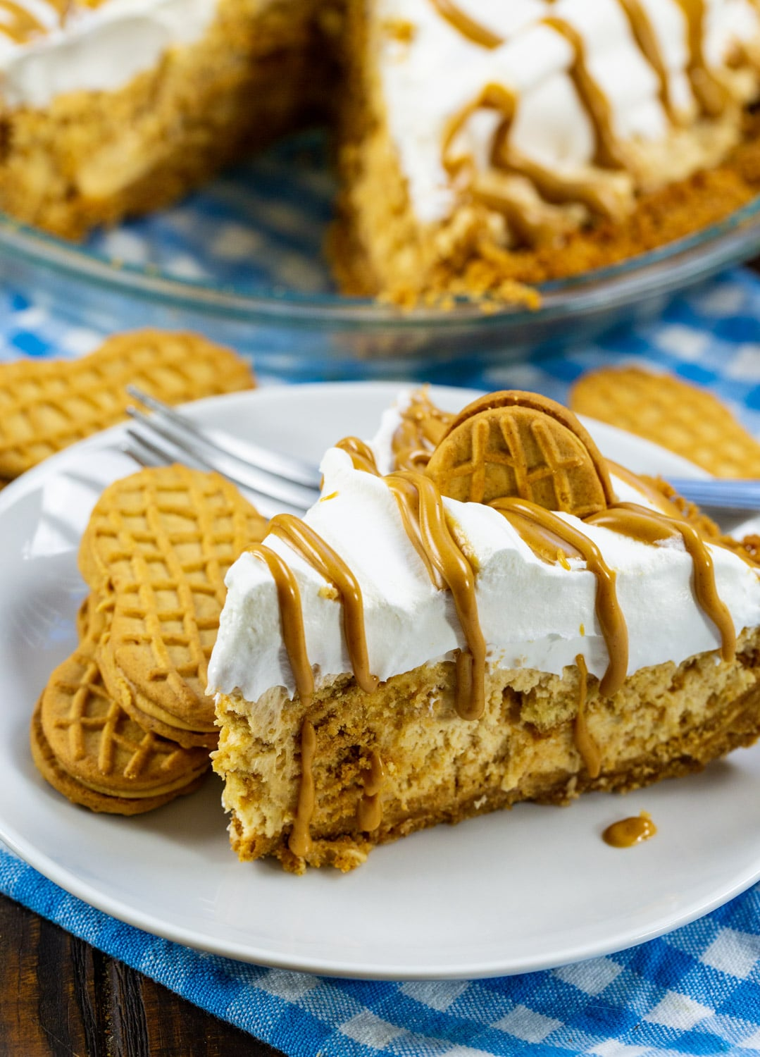 Slice of pie on a plate with 2 Nutter Butter cookies.