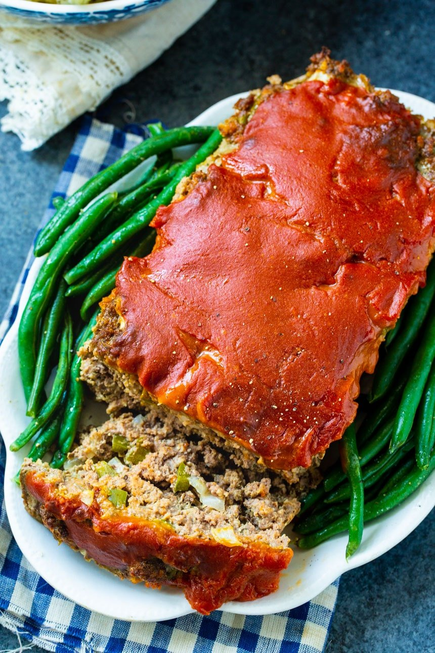 Overhead of meatloaf with one slice cut.