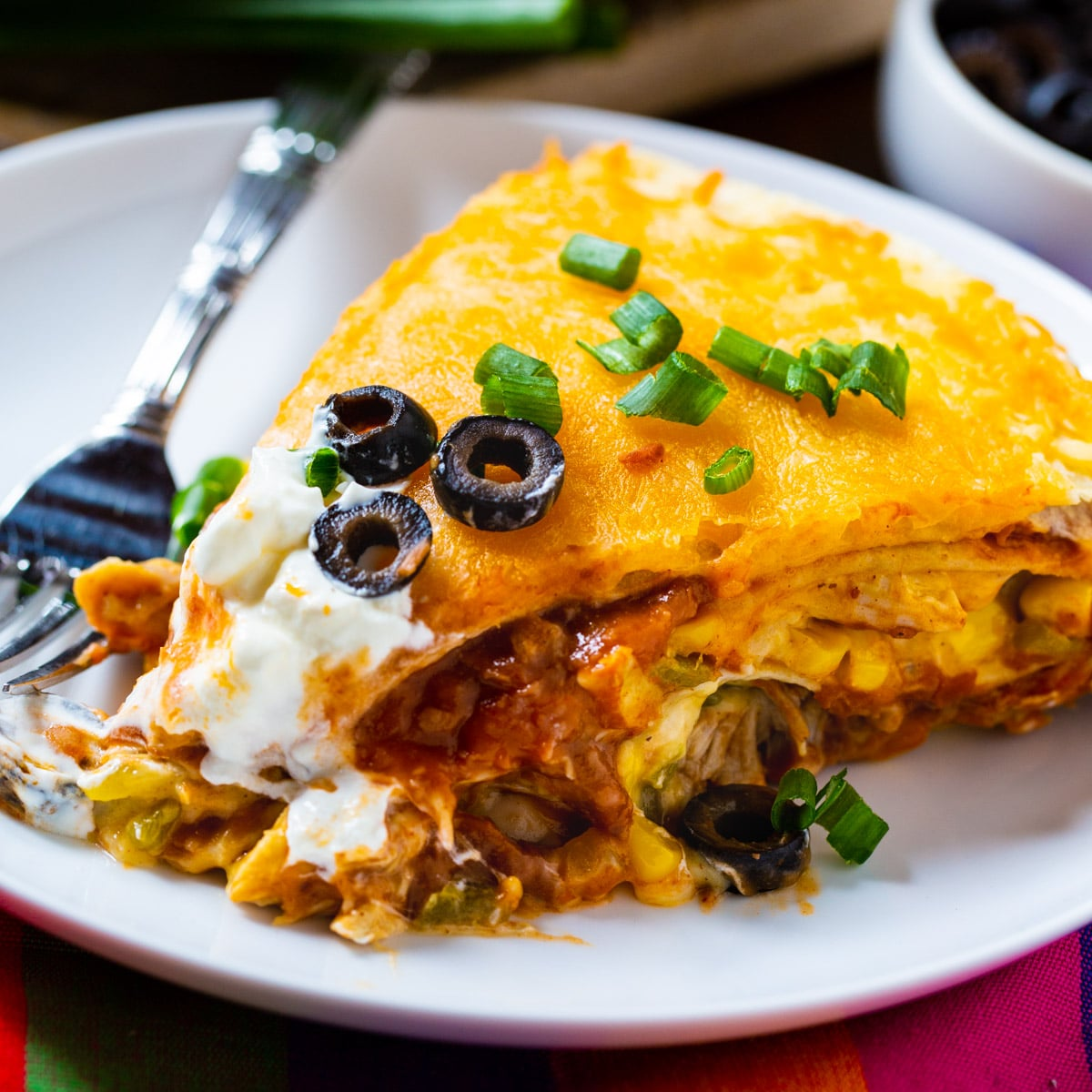Slice of One Pot Chicken Tortilla Pie on a plate.