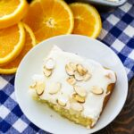 Slice of Almond Orange Sheet Cake with orange slices