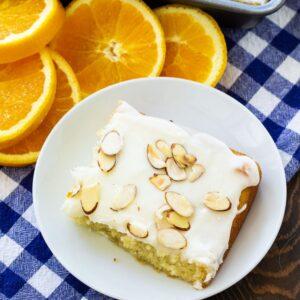 Slice of Almond Orange Sheet Cake with orange slices