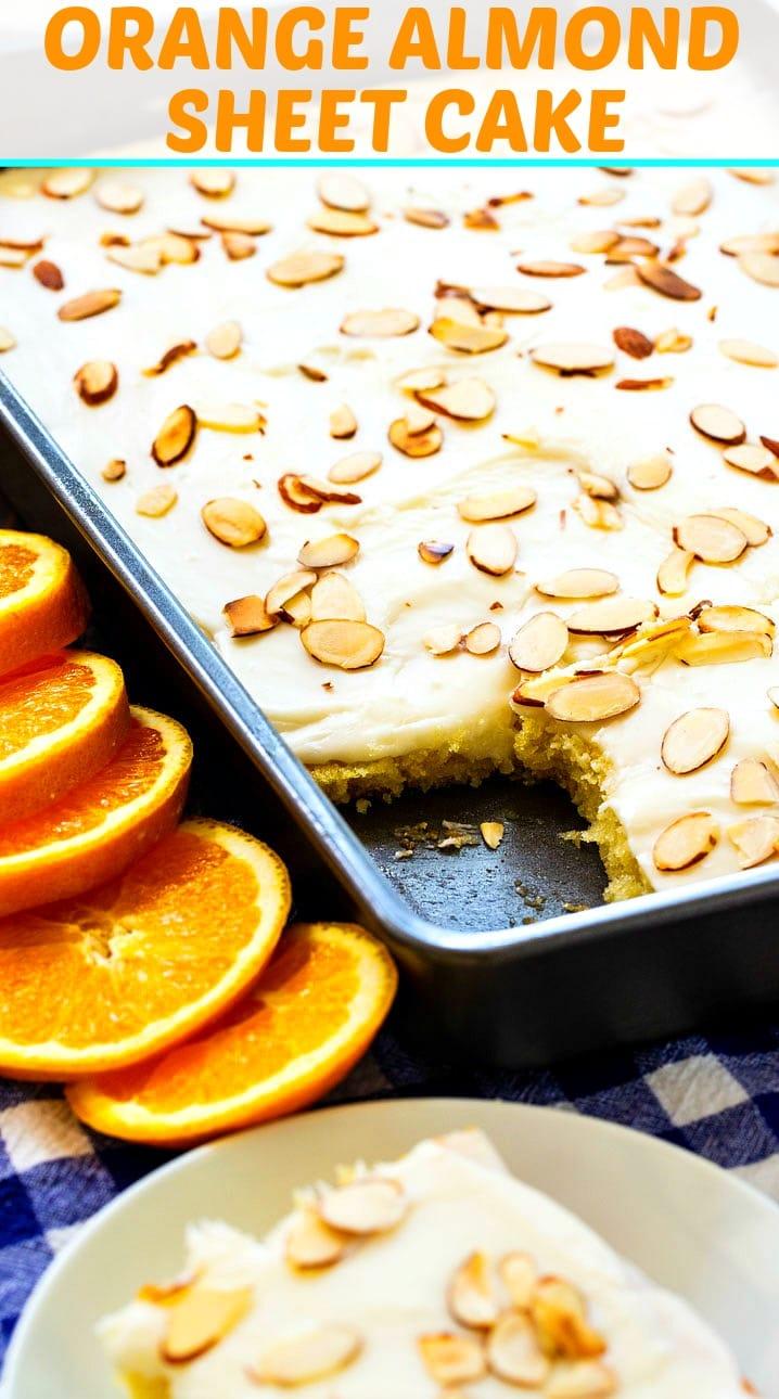 Orange Almond Sheet Cake surrounded by fresh orange slices