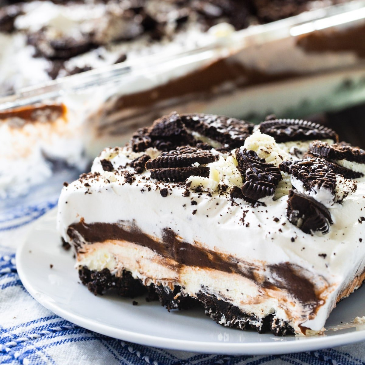 Piece of Oreo Delight on a small white plate.