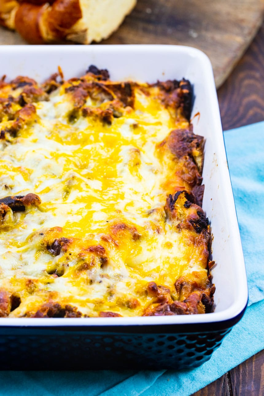 Sausage and Caramelized Breakfast Casserole in blue baking dish.