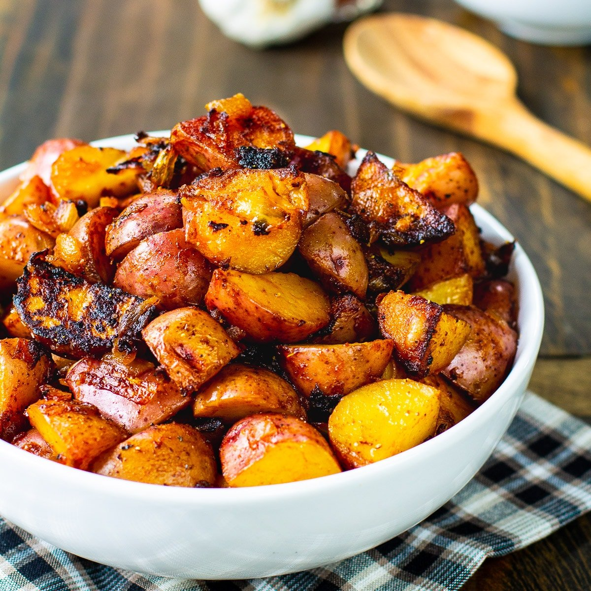 Bowl full of potatoes cooked with paprika.