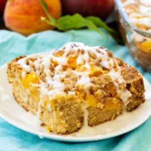 Slice of Peach Crisp Coffee Cake on a white plate