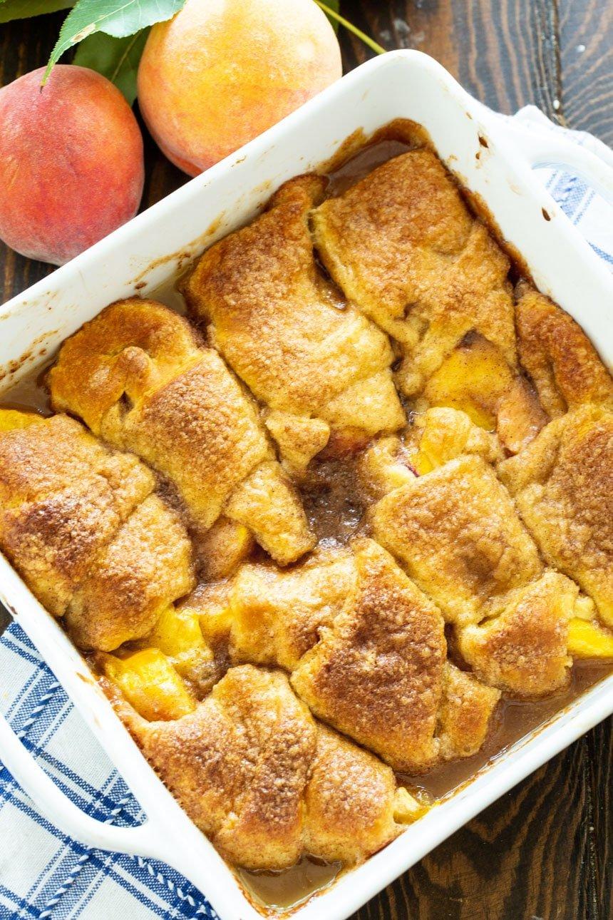 Baking dish full of peach dumplings