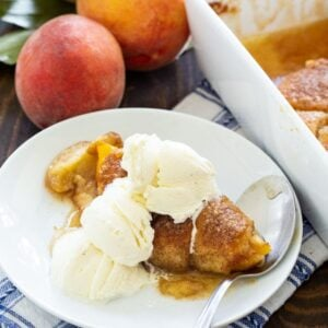 Peach Dumpling on a plate with vanilla ice cream