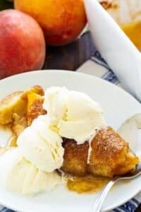 Peach Crescent Dumpling od a plate with ice cream.