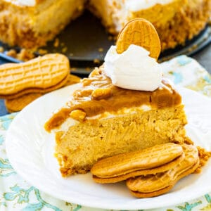 Slice of Peanut Butter Cheesecake on plate with Nutter Butter Cookies