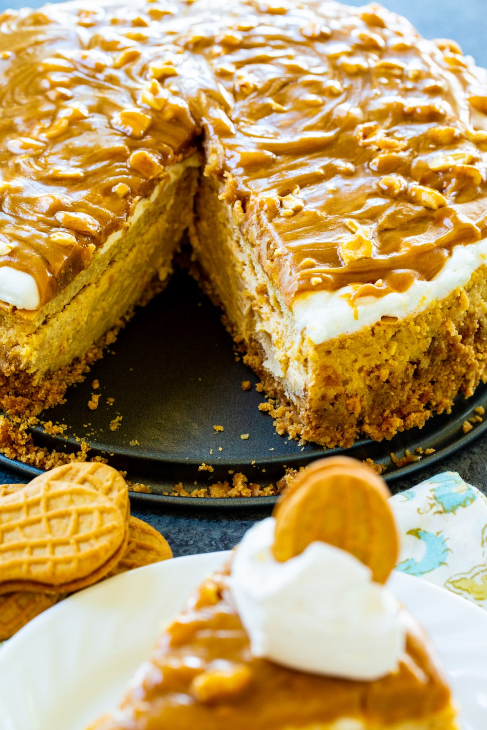 Peanut Butter Cheesecake with a slice cut out.
