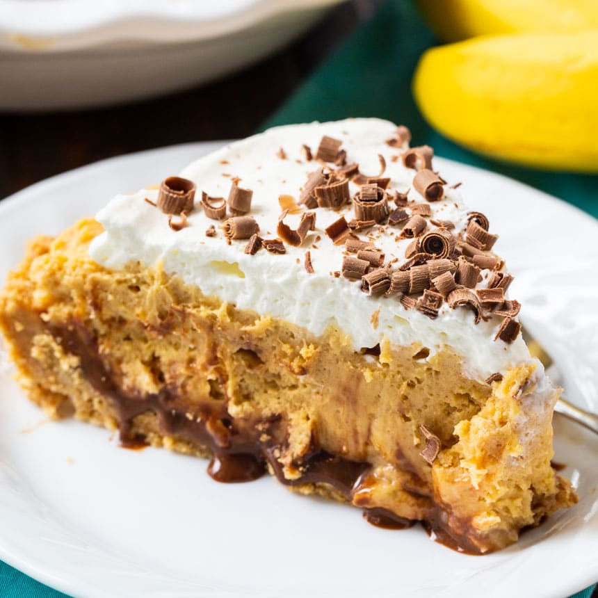 Slice of Peanut Butter Banana Pie on a white plate.