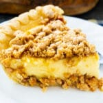 Slice of Peanut Butter Crunch Pie on a plate.