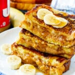 Peanut Butter Stuffed French Toast stacked on a plate.