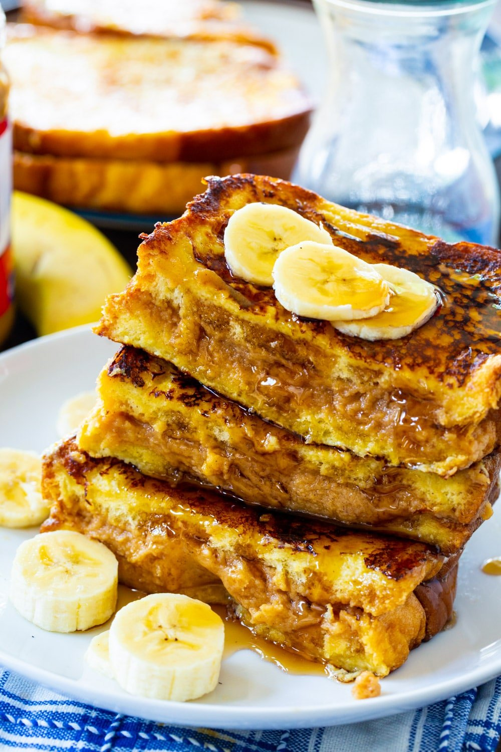 French Toast stuffed with peanut butter on a plate.