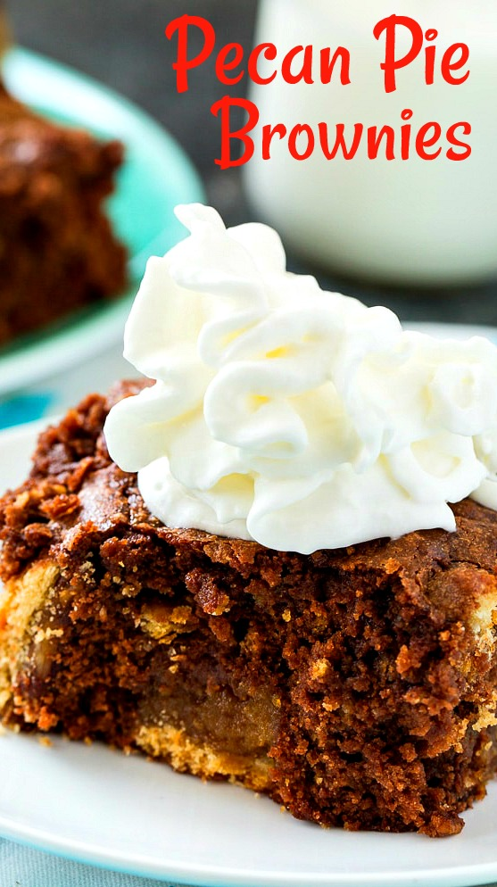 Close-up of brownie topped with whipped cream.
