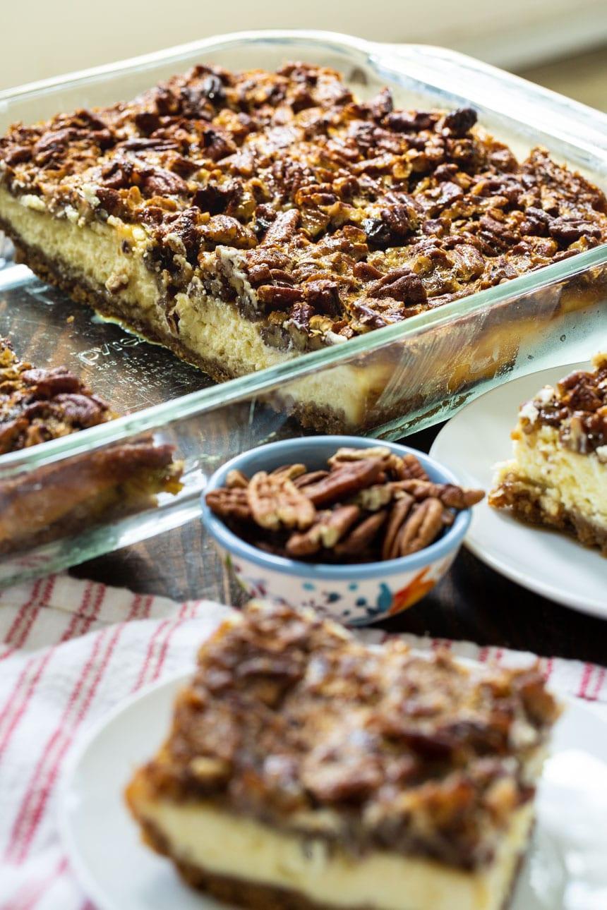 Pecan Pie Cheesecake Bars in a baking dish.